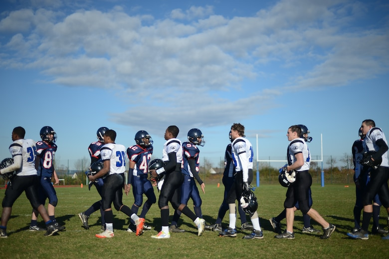 BITBURG ANNEX, Germany – Players from the Bitburg Barons and Hohenfels Tigers congratulate each other after their game at Rik Carr Field Oct. 27, 2012. The Barons defeated the Tigers 56 – 14 in their final home game of the season and clinched a spot in the Department of Defense Dependents Schools Europe Division-II championship for the fourth consecutive year. (U.S. Air Force photo by Staff Sgt. Nathanael Callon/Released)