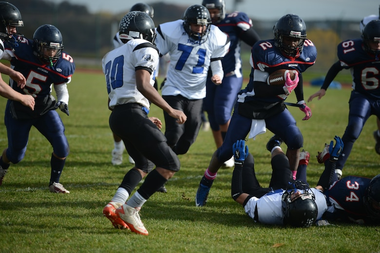 BITBURG ANNEX, Germany – Bitburg Baron senior Corey Evans, from Tampa, Fla., dodges Hohenfels Tigers defenders in the first quarter at Rik Carr Field Oct. 27, 2012. Evans rushed for 185 yards and scored two touchdowns before leaving the game in the second quarter with an ankle injury. (U.S. Air Force photo by Staff Sgt. Nathanael Callon/Released)