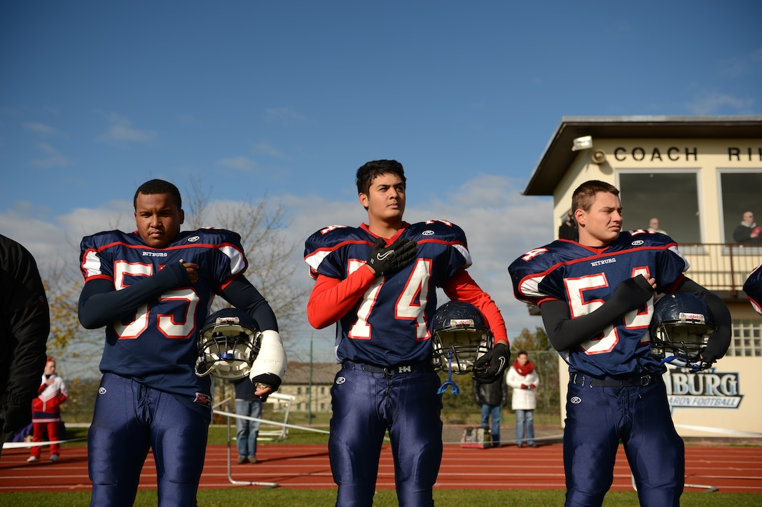 BITBURG ANNEX, Germany – Bitburg Barons players stand for the national anthem before their final home game at Rik Carr Field Oct. 27, 2012. The Barons defeated the Hohenfels Tigers 56 – 14, which earned them a spot in the Department of Defense Dependents Schools Europe Division-II championship game against the Naples Wildcats. (U.S. Air Force photo by Staff Sgt. Nathanael Callon/Released)