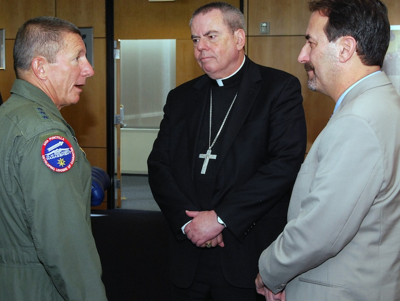 Air Force Academy Superintendent Lt. Gen. Mike Gould speaks with Bishop Michael Sheridan and Scott Levin during the Academy's 2012 religious respect conference. Sheridan represents the Catholic Archdiocese for the Military Services. Levin is director of the Rocky Mountain Region of the Anti-Defamation League. (U.S. Air Force photo/Don Branum)