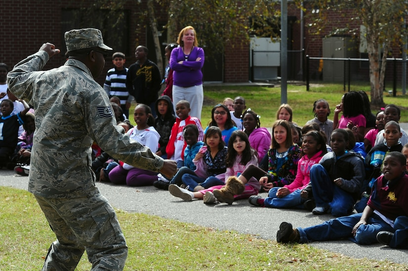 """Tech. Sgt. Maurice Ferguson, 315th Aerospace Medicine Squadron, Drug Demand Reduction program manager, talks with students during Red Ribbon Week Oct. 30, 2012, at Hunley Park Elementary School, North Charleston, S.C. This year's theme is """"The Best Me Is Drug Free."""" The campaign began after the 1985 murder of Federal Drug Enforcement Administration Agent, Enrique Camarena, while he was investigating Mexican drug traffickers. Red Ribbon Week allows educators, parents, community groups, students and others to focus on the work being done by the many who have pledged to live drug free. (U.S. Air Force photo/ Airman 1st Class Chacarra Walker)"""