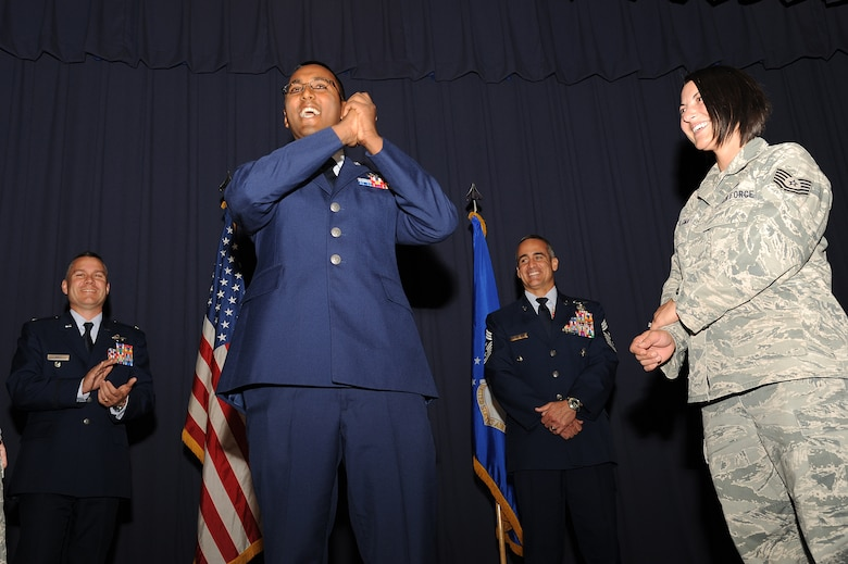 U.S. Air Force Staff Sgt. Alexander Prasadi, a maintenance database manager with 1st Special Operations Medical Operations Squadron, celebrates his promotion to staff sergeant during an NCO recognition ceremony at the King Auditorium on Hurlburt Field, Fla., Oct. 30, 2012. The NCO recognition ceremony welcomes new staff sergeants to the NCO tier. (U.S. Air Force Photo/Airman 1st Class Michelle Vickers)