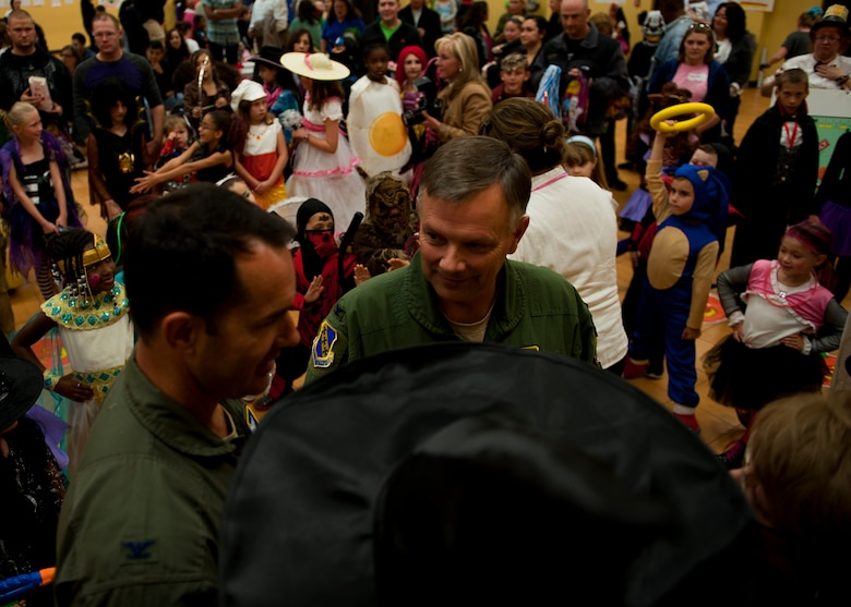 Col. Glen VanHerck, 7th Bomb Wing commander, discusses with fellow judges his opinion on who he thinks the winners of the costume contest should be Oct. 26, 2012, during the Fall Carnival at Dyess Air Force Base, Texas. The carnival had food, games and a haunted house for people to enjoy. (U.S. Air Force photo by Airman 1st Class Damon Kasberg/ Released)
