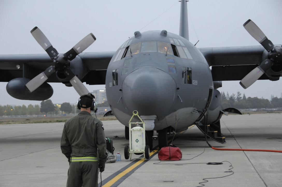 A California Air National Guard aircrew from the 130th Rescue Squadron conducts preflight check on an MC130P Combat Shadow at Moffett Federal Airfield, Calif., Oct 29, 2012.  More than 100 guardsmen from the 129th Rescue Wing  prepare to mobilize to the East Coast to assist with Hurricane Sandy rescue efforts.  Two MC-130P Combat Shadow aircraft, two HH-60G Pave Hawk rescue helicopters and two Guardian Angel Pararescue teams mobilized to the East Coast to provide life-saving rescue capabilities to those in need in the aftermath of Hurricane Sandy.  (Air National Guard photo by Tech. Sgt. Ray Aquino/RELEASED)