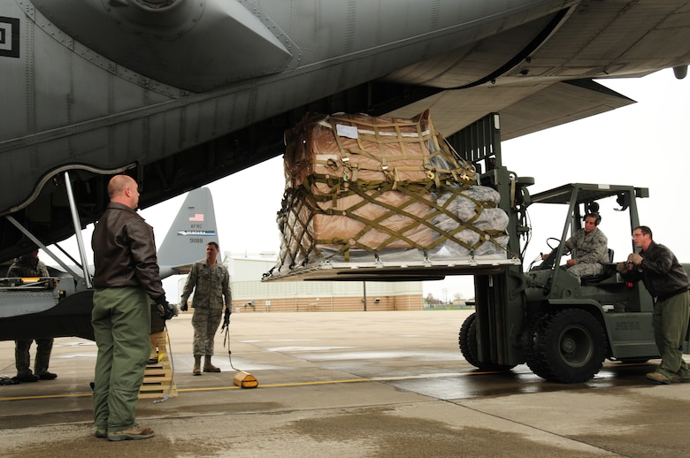 75 members of the 107th Airlift Wing have deployed downstate to aid in Hurricane Sandy recovery efforts. Senior Airman Kimberly Starr, 107th Aerial Port and Master Sgt. Timothy Griffin, 107th Loadmaster moves the cargo onto the C-130 aircraft for the deployment to New York City.  Oct. 30, 2012 (National Guard Photo/Senior Master Sgt. Ray Lloyd)