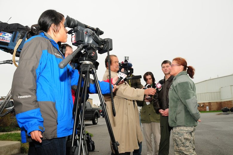 75 members of the 107th Airlift Wing have deployed downstate to aid in Hurricane Sandy recovery efforts. 1st Lt. Cory Bota and Master Sgt. Laura Thomas are interviewed with the local press about their deployment to New York City. Oct. 30, 2012 (National Guard Photo/Senior Master Sgt. Ray Lloyd)