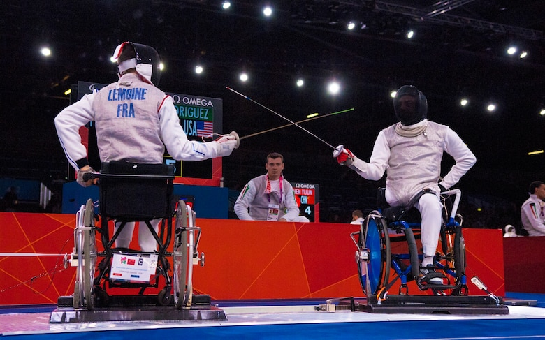Former Air Force Staff Sgt. Mario Rodriguez, right, a member of the 2012 U.S. Paralympic fencing team, squares off with France's Ludov LeMoine at London's ExCel Centre during the Paralympic Games, Sept. 4, 2012. (DOD photo/Sgt. 1st Class Tyrone C. Marshall Jr.)