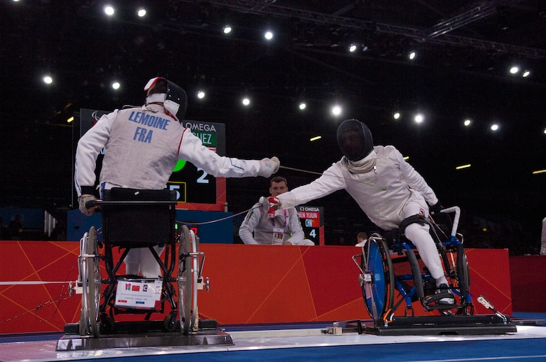 Former Air Force Staff Sgt. Mario Rodriguez, right, a member of the 2012 U.S. Paralympic fencing team, engages France's Ludov LeMoine during a bout at London's ExCel Centre during the Paralympic Games, Sept. 4, 2012. (DOD photo/Sgt. 1st Class Tyrone C. Marshall Jr.)