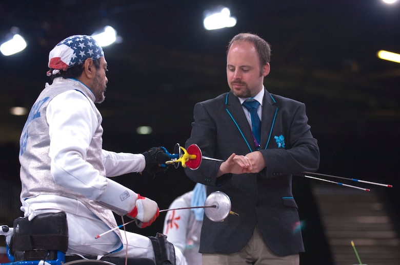 Former Air Force Staff Sgt. Mario Rodriguez, left, a member of the 2012 U.S. Paralympic fencing team, selects his weapon before the start of a bout at London's ExCel Centre during the Paralympic Games, Sept. 4, 2012. (DOD photo/Sgt. 1st Class Tyrone C. Marshall Jr.)