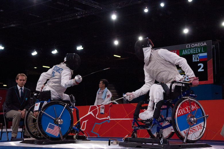 Former Air Force Staff Sgt. Mario Rodriguez, left, a member of the 2012 U.S. Paralympic fencing team, battles Russia's Ivan Andreev at London's ExCel Centre during the Paralympic Games, Sept. 4, 2012. (DOD photo/Sgt. 1st Class Tyrone C. Marshall Jr.)