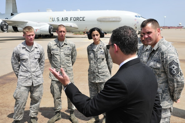 The Honorable Daniel B. Ginsberg, Assistant Secretary of the Air Force for Manpower and Reserve Affairs, visits with crewmembers of the 552nd Air Control Wing, including 552nd ACW Command Chief Master Sgt. Eddie Compton, right, prior to his tour of an E-3 Sentry Airborne Warning and Control System (AWACS) aircraft. Secretary Ginsberg toured the E-3 as part of his visit to Tinker Air Force Base on Thursday, Aug. 16 to learn more about the base and its diverse mission. (U.S. Air Force photo by Darren D. Heusel)