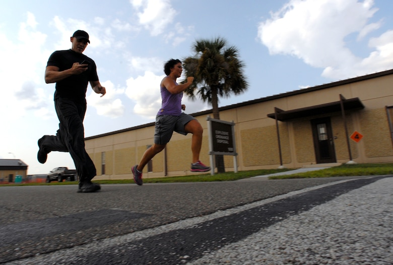 125th Fighter Wing Medical Service Journeyman, Staff Sgt. Mariam Abdallah (right), finishes a 400 yard run with 125th Fighter Wing Health Promotions Officer, Captain Jesus Garcia by her side,125th Fighter Wing, Jacksonville, Fla, August 18, 2012. Garcia and his partner Christina Sox,  have developed an easy to follow fitness plan utilizing Tabata, a high intensity interval training tool aimed to help members of the 125th Fighter Wing, Florida Air National Guard meet their fitness goals.  (Air National Guard photo by MSgt. Shelley Gill)