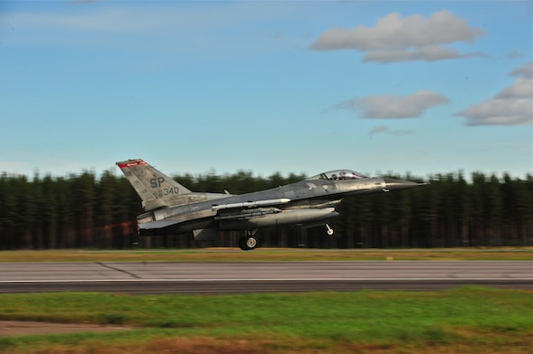 KALLAX AIR BASE, Sweden -- Maj. Brian Scott, 480th Fighter Squadron pilot, takes off from the runway in an F-16 Fighting Falcon aircraft here Sept. 3 during a flight at the Nordic Air Meet 2012. The multinational training exercise brought together more than 50 aircraft from the United States, Great Britain, Denmark, Finland, Switzerland and Sweden to participate in tactical role-playing training missions. The three week exercise enabled the different nations to exchange aerial tactics and capabilities to improve combat power effectiveness in solo and joint environments while building and strengthening international partnerships. (U.S. Air Force Photo by Airman 1st Class Dillon Davis/Released)