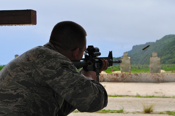 ANDERSEN AIR FORCE BASE, Guam -- Airman 1st Class Dalton Ridder, 36th Civil Engineer Squadron pavement and construction equipment apprentice, fires his weapon during the qualification portion of combat arms training here Aug. 28. The Air Force recently implemented a new weapons qualification course that contains both the original basic firing positions and a new section that includes advanced tactical movements. (U.S. Air Force photo by Airman 1st Class Marianique Santos/Released)