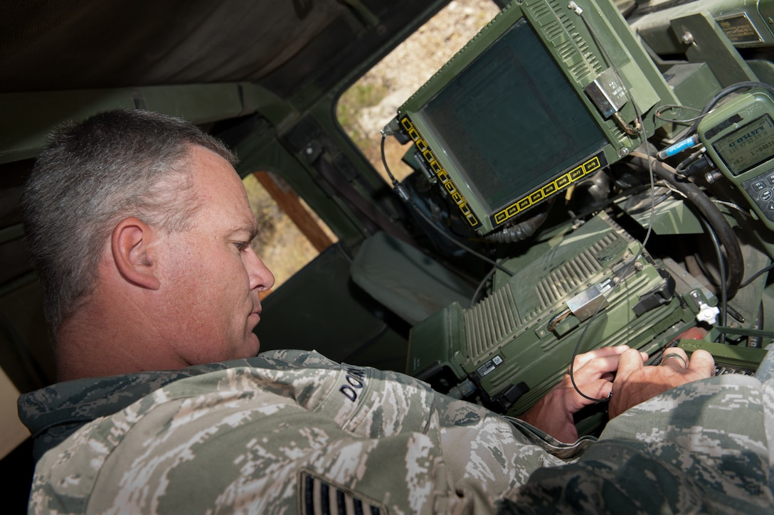 Tech. Sgt. Bradley Dobson, 124th Air Support Operations Squadron, communicates with fellow Idaho National Guardsmen through the Blue Force Tracker as part of the Idaho National Guard's support to the Trinity Ridge Fire's containment efforts near Idaho City, Idaho, Aug. 24. Airmen and Soldiers with the Idaho National Guard help to provide a safe perimeter around the Trinity Ridge Fire nine miles north of Idaho City in order to help firefighters protect threatened property and area residents. (U.S. Photo by Staff Sgt. Bob Barney)