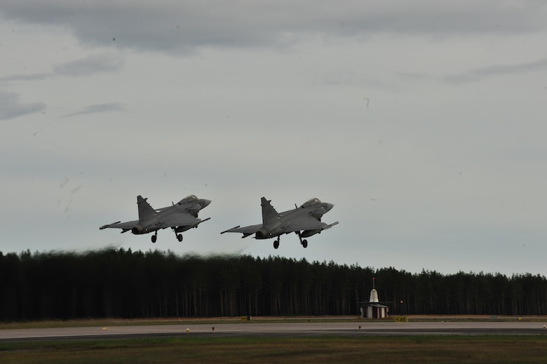 KALLAX AIR BASE, Sweden -- Two Swedish air force JAS 39 Griffin aircraft take off in a two-ship formation here Sept. 3, in support of the Nordic Air Meet 2012. The multinational training exercise brought together more than 50 aircraft from the United States, United Kingdom Denmark, Finland, Switzerland and Sweden to participate in tactical role-playing training missions. The three week exercise enabled the different nations to exchange aerial tactics and capabilities to improve combat power effectiveness in solo and joint environments while building and strengthening international partnerships. (U.S. Air Force Photo by Airman 1st Class Dillon Davis/Released)