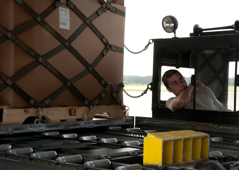 Senior Airman Ivan Fernandez, 437th Aerial Port Squadron air transportation journeyman, ensures the 60k tunner is positioned properly to load an aircraft Aug. 29, 2012, at Joint Base Charleston – Air Base, S.C. The 60k tunner is used to load and unload pallets from aircraft. (U.S. Air Force photo by Staff Sgt. Katie Gieratz)