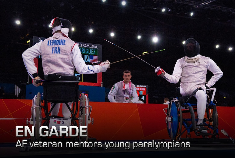Former Air Force Staff Sgt. Mario Rodriguez, right, a member of the 2012 U.S. Paralympic fencing team, squares off with France's Ludov LeMoine during the Paralympic Games in London, on Sept. 4, 2012. Rodriguez elected to have his leg removed in 1992 after an untreatable tumor was discovered. (Department of Defense photo/Sgt. 1st Class Tyrone C. Marshall Jr.)