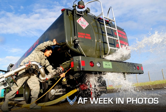 Senior Airman Andrew Leal shuts off the valve of a fuel truck during a major accident response exercise at Royal Air Force Mildenhall, England, on Aug. 30, 2012. The exercise simulated a fuel spill due to a cracked flange connection during a fuel transfer. Leal is a 100th Logistics Readiness Squadron, fuels technician. (U.S. Air Force photo by Senior Airman Ethan Morgan)