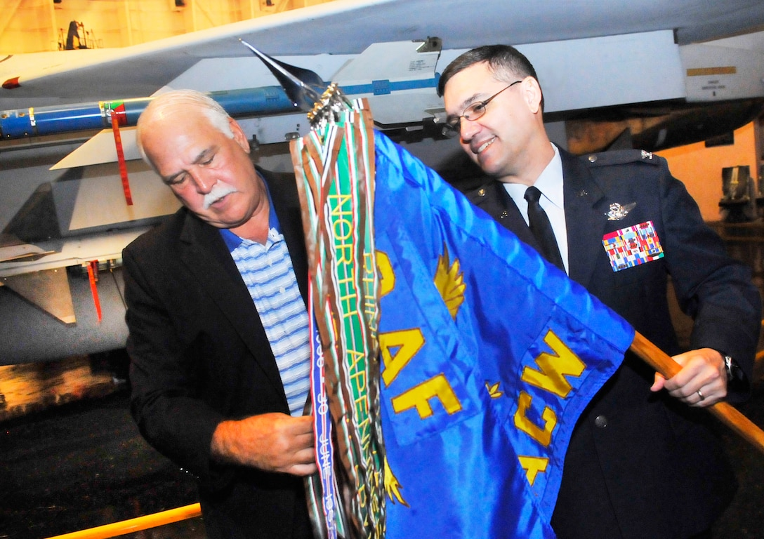 Col Dean Worley, right, 461st Air Control Wing commander, shows new honorary commander, Mike Dyer, Greater Macon Chamber of Commerce president, the 461st ACW guidon. A ceremony was held at the Museum of Aviation Friday to induct new commanders into the Honorary Commanders Program program for the  2012-2013 term . The program began in 2005 and was exclusive to the Warner Robins Air Logistics Center. However, with the current restructure, the program is now targeted to Team Robins to include mission partners. It is designed to encourage an exchange of ideas, experiences, and friendship between key members of the local civilian community and members of Team Robins.  The program is a method to foster a supportive relationship between the base and the community, increase military involvement in civic endeavors and organizations and make the members of the local community part of the Robins AFB family (U. S. Air Force photo/Sue Sapp)