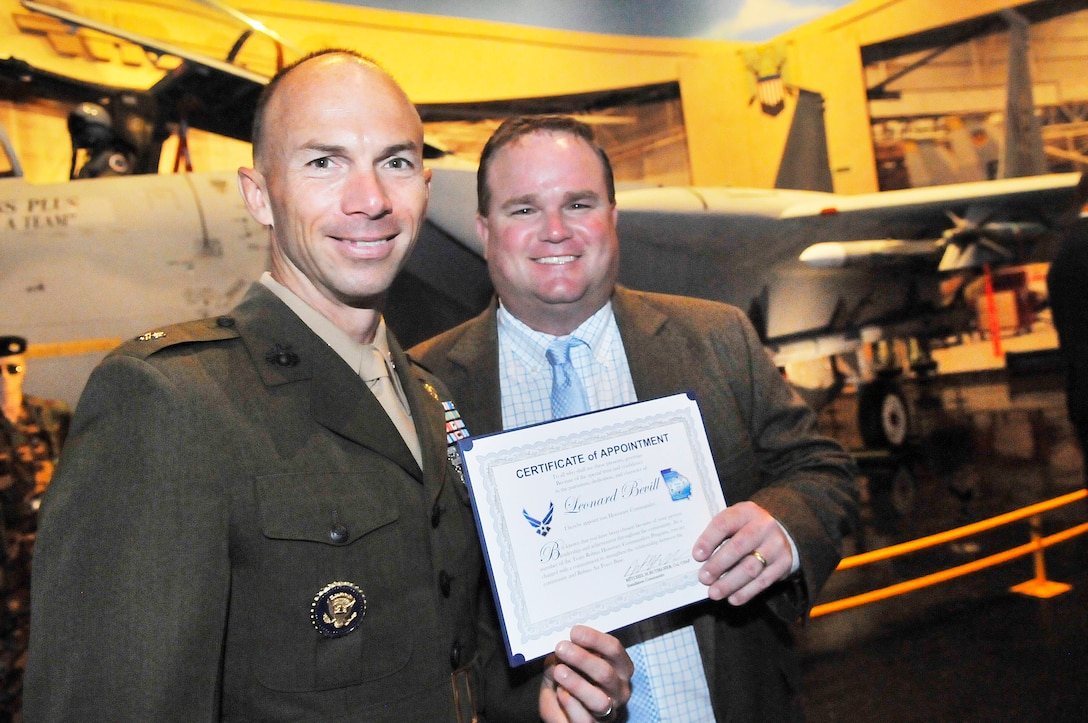 Lt. Col. David Steele, Marine Aircraft Group 49, Det A commander, stands with new honorary commander Leonard Bevill, Macon Occupational Medicine owner/president. A ceremony was held at the Museum of Aviation Friday to induct new commanders into the Honorary Commanders Program program for the  2012-2013 term . The program began in 2005 and was exclusive to the Warner Robins Air Logistics Center. However, with the current restructure, the program is now targeted to Team Robins to include mission partners. It is designed to encourage an exchange of ideas, experiences, and friendship between key members of the local civilian community and members of Team Robins.  The program is a method to foster a supportive relationship between the base and the community, increase military involvement in civic endeavors and organizations and make the members of the local community part of the Robins AFB family (U. S. Air Force photo/Sue Sapp)