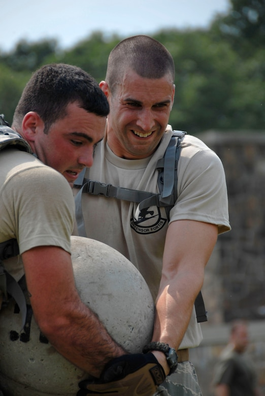 Airman 1st Class Francis Gelada and Staff Sgt. Christopher Sixt of the 103rd Security Forces Squadron assist each other carrying a weighted ball as part of the PT portion of the Connecticut SWAT Challenge in West Harford, Conn., Aug. 23, 2012. The Air Guard team took top military team honors for the seventh straight year, fourth in the PT portion and 12th place overall in the annual competition. (U.S. Air Force photo by Senior Airman Jennifer Pierce/Released)