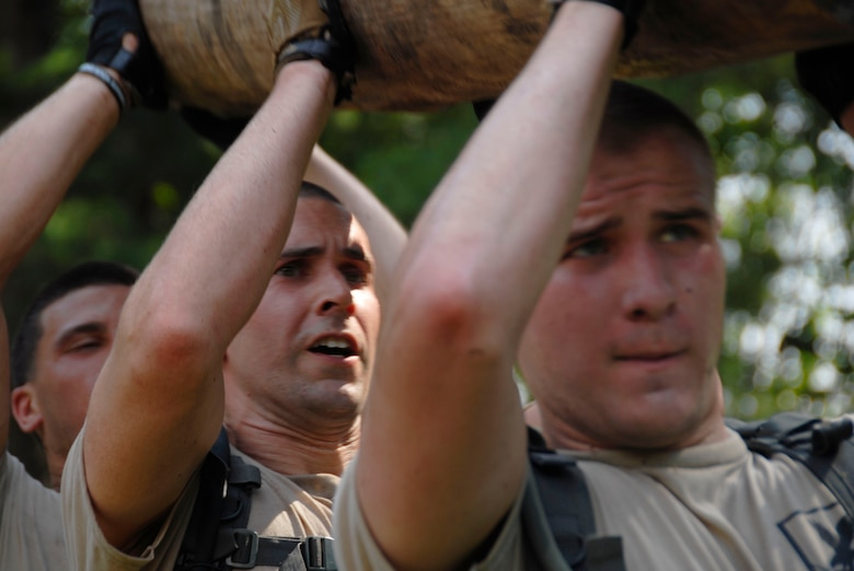 Members of the 103rd Security Forces Squadron hoist a log up during the PT portion of the Connecticut SWAT Challenge in West Harford, Conn., Aug. 23, 2012. (U.S. Air Force photo by Senior Airman Jennifer Pierce/Released)