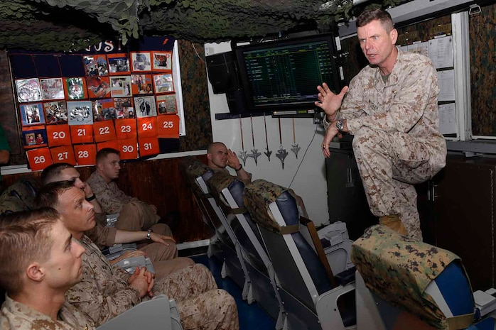 Major General William Beydler, U.S. Central Command J-5, director, strategy, plans and policy,  speaks to Marine officers of Marine Fighter Attack Squadron 251 during his visit aboard aircraft carrier USS Enterprise, Aug. 19. The carrier is currently in the U.S. 5th Fleet area of responsibility in support of Operation Enduring Freedom.