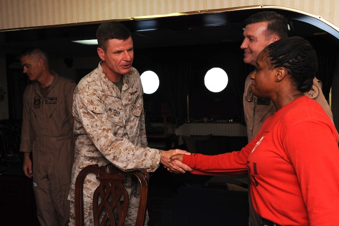 Major General William Beydler, U.S. Central Command J-5, director, strategy, plans and policy,  shakes hands with Sgt. Maj. Leveta Smith, Marine Fighter Attack Squadron 251 sergeant major, during his initial meeting with the squadron's commanding officer and sergeant major, Aug. 19. The squadron also met British Royal Marines as they came aboard USS Enterprise during their deployment.
