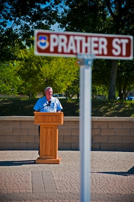 Retired Maj. Gen. Gerald Prather thanks attendees after learning that the street Freedom Way was renamed to Prather Street in his honor at Laughlin Air Force Base, Texas, Sept. 7, 2012. Prather is one of 77 people to have a street or building named after them while still alive in the Air Force's 64 year history. (U.S. Air Force photo/Senior Airman Scott Saldukas)