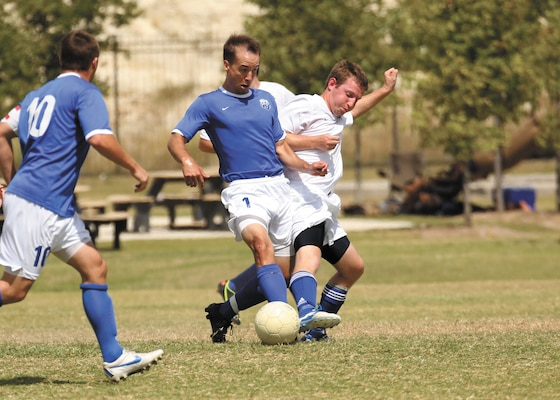Sam Page (middle) of Joint Base San Antonio-Randolph soccer team competes against the Columbus Air Force Base soccer team during the Defender Cup tournament, Sept. 2. (U.S. Air Force photo/Robbin Cresswell)