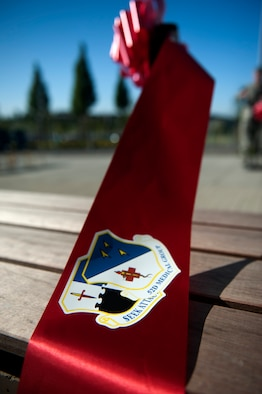 SPANGDAHLEM AIR BASE, Germany – A cut ribbon rests on a bench in front of the new 52nd Medical Group clinic here Sept. 7.  The $30.1 million clinic officially opens Sept. 10 and includes a larger parking lot, a 75,000 square foot building, 23 exam rooms, 218 medical professionals, and new medical equipment and furniture.  (U.S. Air Force photo by Airmen 1st Class Gustavo Castillo/Released)