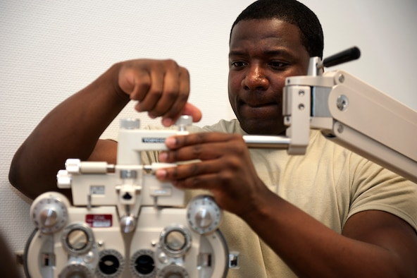SPANGDAHLEM AIR BASE, Germany – Tech. Sgt. Douglas Cox, 52nd Medical Support Squadron biomedical equipment repair technician, assembles an optometry chair in the new 52nd Medical Group clinic here Sept. 5.  The 52nd Medical Group has spent the last few weeks moving all sections of the previous building, into the new one.  The $30.1 million clinic officially opens Sept. 10 and includes a larger parking lot, a 75,000 square foot building, 23 exam rooms, 218 medical professionals, and new medical equipment and furniture.  (U.S. Air Force photo by Airmen 1st Class Gustavo Castillo/Released)