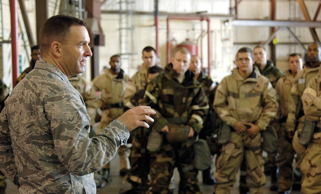 """Col. Tom Engle, 552nd Air Control Wing vice commander, addresses wing Airmen before the first half-day session of a two-day Ability to Survive and Operate, or ATSO,  training course held in a wing hangar.  The colonel reminded the Airmen how important this training was.  """"We need to train on things we don't do daily,"""" he said. """"We're deploying all the time, but we don't do this. If you don't know how to do this, it's a vulnerability,"""" he stressed. The Airmen rotated through five stations, training how to correctly put on MOPP gear and help others put it on, medical Self-Aid Buddy Care, correct decontamination procedures and how to give a detailed SALUTE report to security personnel about any suspicious people or activities. (Air Force photo by Margo Wright)"""
