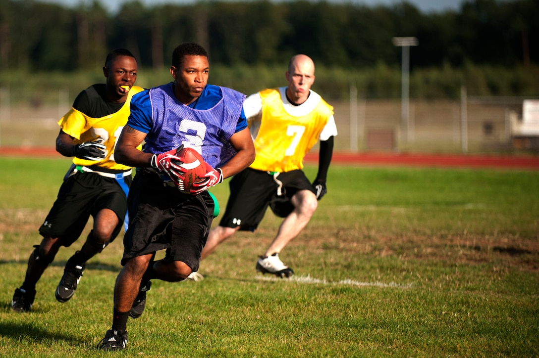 SPANGDAHLEM AIR BASE, Germany – Donnel Carney, 52nd Logistics Readiness Squadron unit deployment manager, runs down the field during a flag football game near the Skelton Memorial Fitness Center here Sept. 5.  Carney is the first-string quarterback for the 52nd LRS team and scored one touchdown during their first game of the season.  The flag football season will continue until Oct. 31, thereafter the top eight teams will compete for the base championship title in a single elimination tournament. (U.S. Air Force photo by Airman 1st Class Gustavo Castillo/Released)