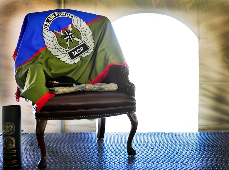 A stand alone chair, decorated with a flag from Senior Airman Bradley Smith's unit and his uniform, symbolizes his absence during a Silver Star ceremony in Troy, Ill., Sept. 8, 2012. (U.S. Air Force photo/ Staff Sgt. Stephenie Wade)