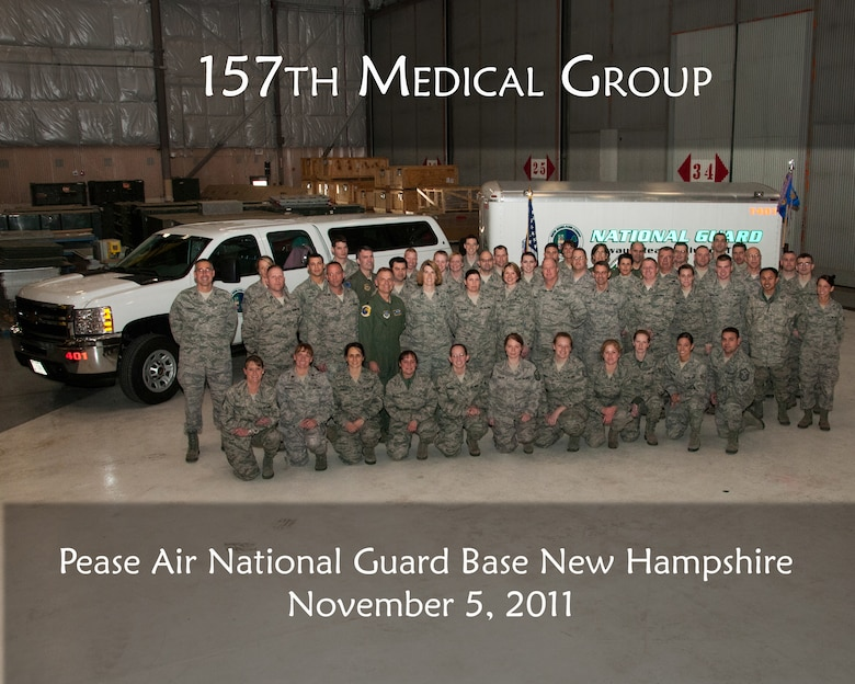 Members of the 157th Medical Group's Chemical Biological Radiological Nuclear High Yield Explosive Enhanced Response Force Package (CERFP) pose for a photo, Pease Air National Guard Base, N.H., November 5, 2011.  (National Guard photo illustration  by Staff Sgt. Curtis J. Lenz/RELEASED)
