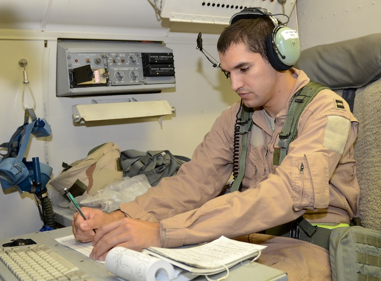 A U.S. Air Force navigator on an E-8C Joint STARS reviews a flight plan prior to a sortie during an operational readiness inspection at Robins Air Force Base, Ga., Sept. 8, 2012.  Airmen from the 116th and 461st ACW are showcasing their ability to perform assigned tasks in wartime, contingency or force sustainment operation. Inspection areas include initial response, employment, mission support and ability-to-survive and operate in a chemical environment. (National Guard photo by Master Sgt. Roger Parsons/Released)
