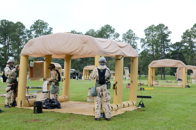 U.S. Air Force Airmen from Team Joint STARS 116th and 461st Air Control Wings set up a contamination control area (CCA) during an operational readiness inspection at Robins Air Force Base, Ga., Sept. 6, 2012.  The CCA was used to decontaminate simulated victims of chemical or biological attacks during the inspection. Portions of this image have been blurred for security reasons. (National Guard photo by Master Sgt. Roger Parsons/Released)
