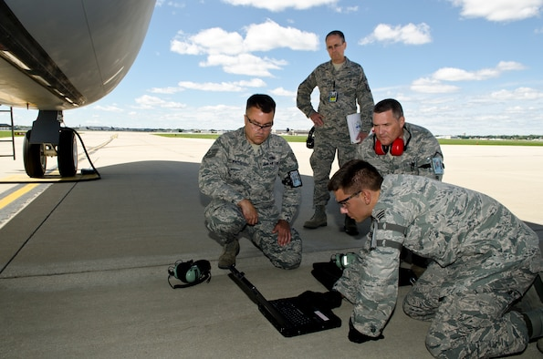 Members of the 128th Air Refueling Wing's Maintenance Squadron reference their technical orders for a KC-135 Stratotanker while an Air Force Inspector evaluates them during a Compliance Inspection at the 128 ARW, Milwaukee, Sept. 8, 2012. From left, Tech. Sgt David Wincell, Senior Airman Justin Henrichs, and Master Sgt Thomas Proctor worked to complete a task assigned and evaluated by the Air Force Inspector to check the compliance with Air Force tasks, procedures, and protocols. (Air National Guard Photo by Tech. Sgt Thomas Sobczyk / Released)