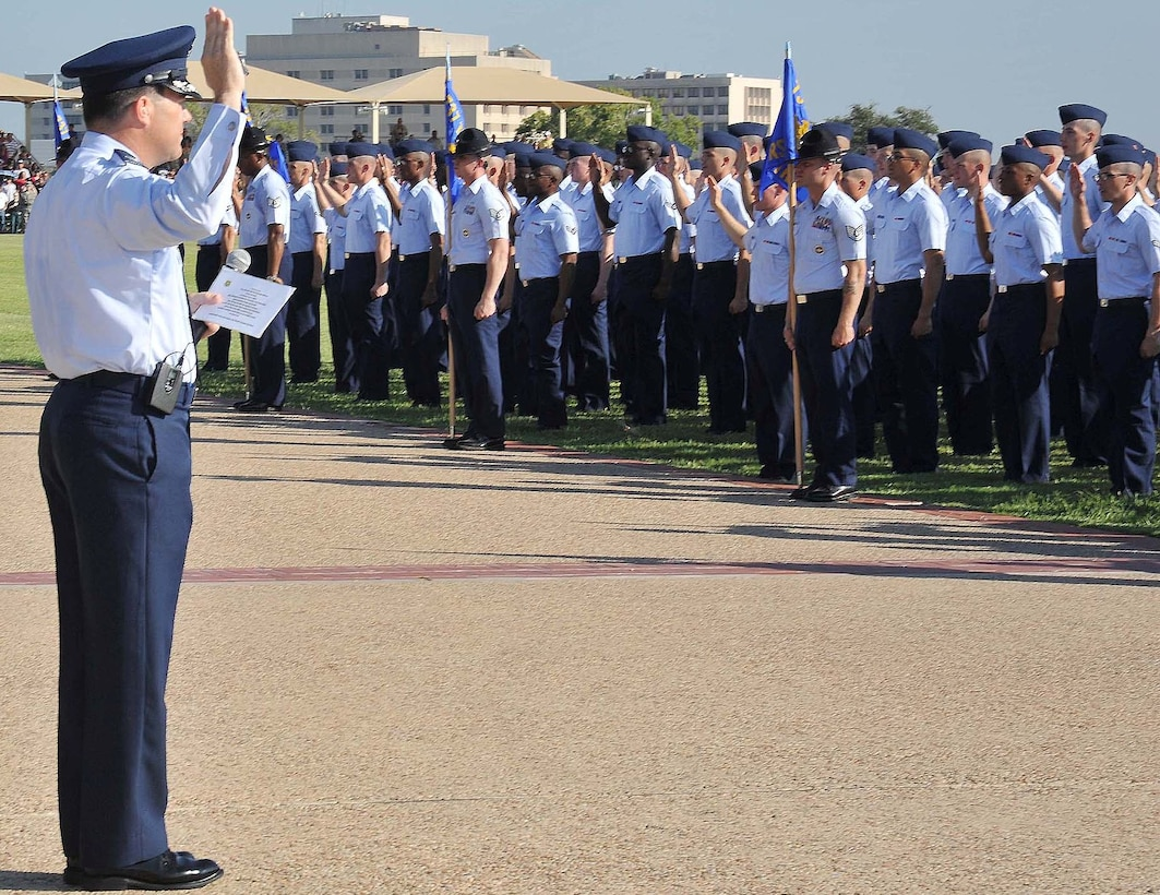Col. Jerry Couvillion, Air Force Personnel Center, administers the oath of enlistment to the Sept. 7 Air Force basic training graduates, one of whom was his son Airman Basic Patrick Couvillion. (U.S. Air Force photo by Alan Boedeker)