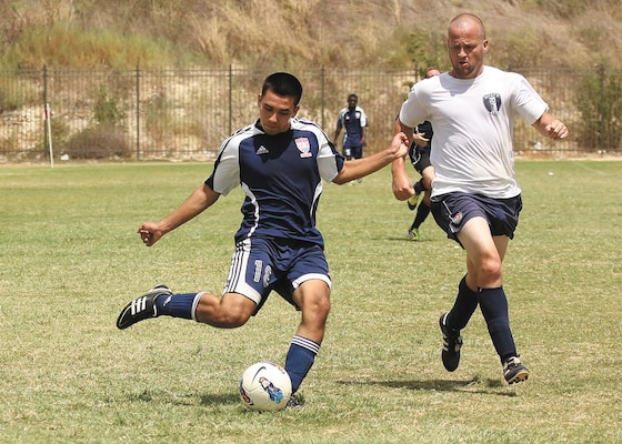 Warhawks midfielder David Ramos passes the ball forward in front of a Wright-Patterson defender during a Sept. 2 Defender Cup soccer matchup. Wright-Patterson eliminated the Warhawks, 4-1. (U.S. Air Force photo/Robbin Cresswell)