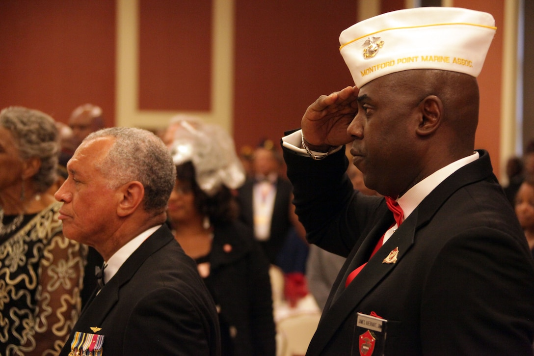 Maj. Gen. Charles F. Bolden (ret.), 12th Administrator of NASA, and Dr. James T. Averhart Jr., president of the Montford Point Marines Association pay respects during the annual Montford Point celebration aboard Marine Corps Base Camp Lejeune Aug. 25. Bolden was the events guest speaker.