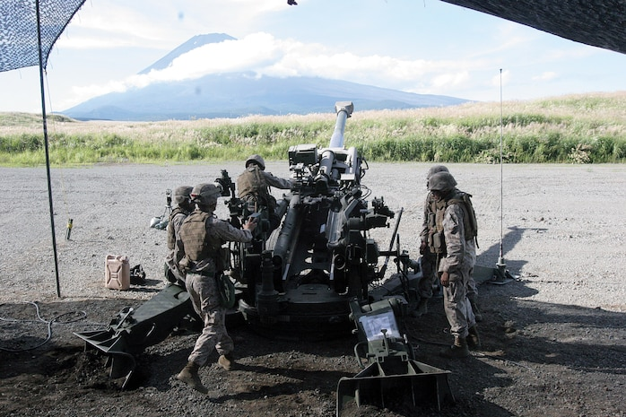 Marines prepare to fire rounds from an M777A2 155 mm howitzer at East Fuji Maneuver Area in mainland Japan, Sept. 11. The Marines wait for fire commands from the fire direction center prior to sending rounds downrange. The Marines are with Battery O, 5th Battalion, 14th Marine Regiment, 4th Marine Division, assigned to 3rd Battalion, 12th Marines, 3rd Marine Division, III Marine Expeditionary Force, under the unit deployment program.