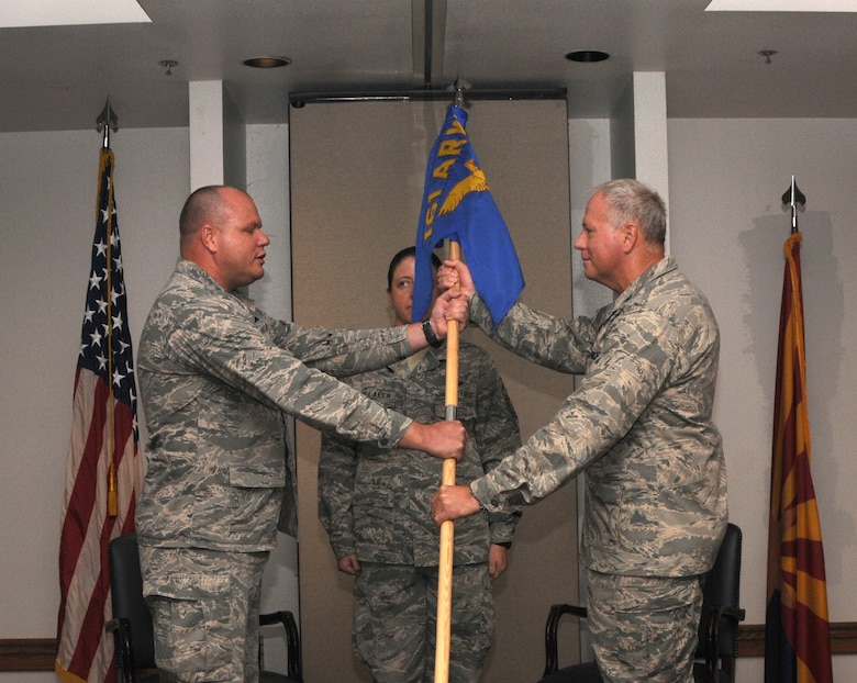 Col. Joseph B. Wilson accepts command of the 161st Maintenance Group from Col. Gary D. Brewer Jr., Sept. 8, 2012, at Phoenix Sky Harbor Air National Guard Base. Colonel Wilson's previous assignment was as the Air National Guard Advisor to the commander, Oklahoma City Air Logistics Center, Tinker Air Force Base, Okla. (U.S. Air Force photo by Senior Airman Rashaunda Williams/Released)