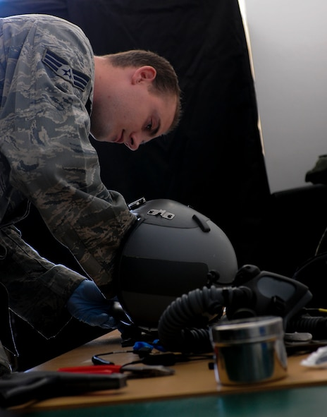 NAMEST AIR BASE, Czech Republic -- Senior Airman Brandon Keiper, 52nd Operations Support Squadron flight crew equipment maintainer, adjusts parts of a pilot's helmet as part of a 30-day inspection Sept. 10, during Ramstein Rover 2012 here.The 81st Fighter sqaudron is participating in RARO 12 to build partnerships and exchange tactics techniques and procedures with more than 16 NATO nations. A-10 Thunderbolt IIs from the 81st Fighter Squadron are providing close air support to partnering nations and practicing forward air control missions with their NATO allies in international security assistance force realistic scenarios throughtout the exercise. Participating in exercises like RARO 12 ensures effective employment of airpower in support of alliance or coalition forces while mitigating risks to civilians in contingency operations. (U.S. Air Force photo by Senior Airman Natasha Stannard/Released)