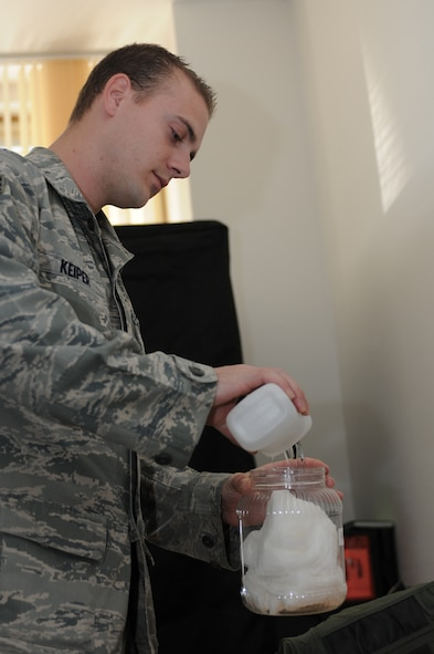NAMEST AIR BASE, Czech Republic -- Senior Airman Brandon Keiper, 52nd Operations Support Squadron flight crew equipment maintainer, pours cleaning alcohol into a jar of cotton swabs used to clean flight equipment as part of a 30-day inspection Sept. 10, during Ramstein Rover 2012 here. RARO 12 is a NATO partnership building exercise invlolving more than 16 nations. A-10 Thunderbolt IIs from the 81st Fighter Squadron are providing close air support to partnering nations and practicing forward air control missions with their NATO allies in international security assistance force realistic scenarios throughtout the exercise. Participating in exercises like RARO 12 ensures effective employment of airpower in support of alliance or coalition forces while mitigating risks to civilians in contingency operations. (U.S. Air Force photo by Senior Airman Natasha Stannard/Released)