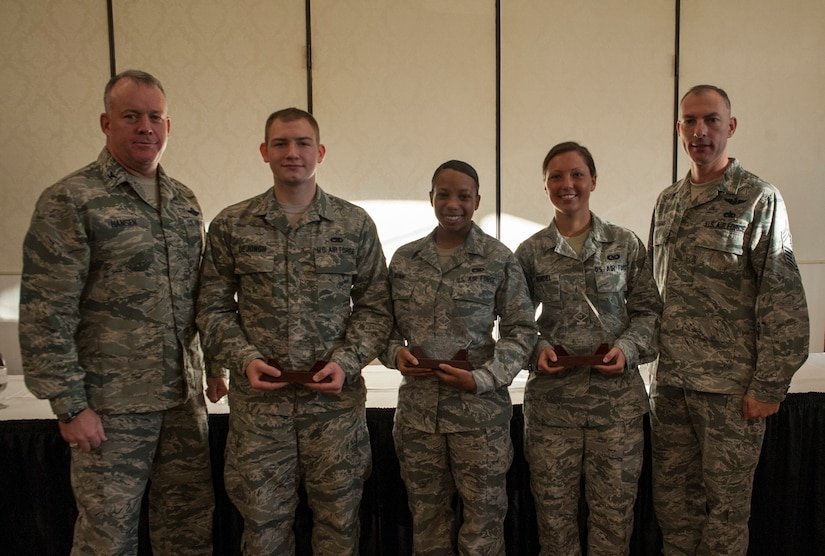 Colonel Erik Hansen, 437th Airlift Wing commander and Chief Master Sgt. Larry Williams, 437th Airlift Wing command chief, pose with the Diamond Sharp Award winners Sept. 11, 2012, at Joint Base Charleston – Air Base, S.C. (Left to right) Senior Airmen Joshua DeJongh, 437th Aircraft Maintenance Squadron, Airman 1st Class Tiffany Nunn, 437th Maintenance Squadron and Airman 1st Class Meghan Wendel, 437th Operations Support Squadron were recognized. Not pictured is Staff Sgt. Brandon Doyle, 437th Aerial Port Squadron. The Diamond Sharp award recognizes Airmen whose outstanding performance stands out to their first sergeant. (U.S. Air Force photo/Airman 1st Class Ashlee Galloway)