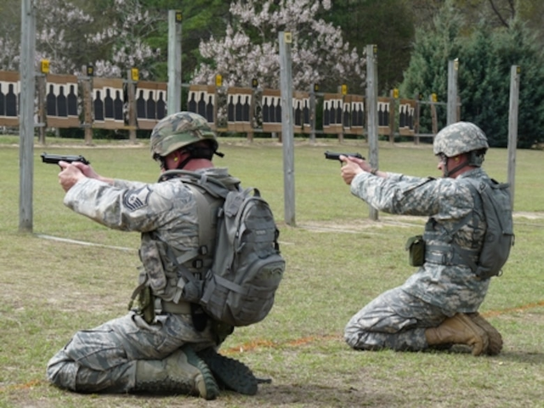 Master Sgt. Benjamin Israel (left) and Staff Sgt. Jody Salcido, shoot in a pistol match at Fort Benning, Ga., during the 2012 U.S. Army Small Arms Championships held March 1-10. The Missouri National Guard's four-man team took second place at the preeminent marksmanship training and competition. (Ann Keyes/Missouri National Guard)