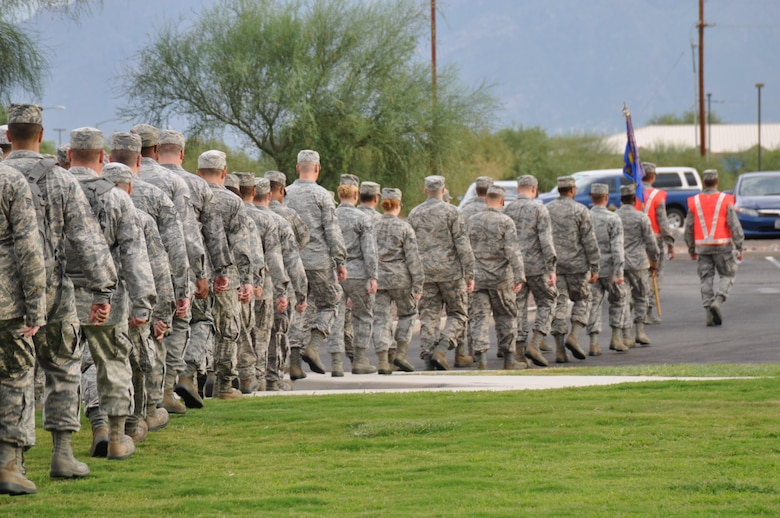 The 612th Air Communications Squadron departs after completing a Memorial March to honor 9/11 victims, Sept. 11. (U.S. Air Force photo by Master Sgt. Kelly Ogden).